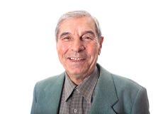 Uśmiechnięty starszy mężczyzna nad bielem Zdjęcia Royalty Free