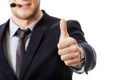 Uśmiechnięty telefonu operator z aprobatami Zdjęcia Stock
