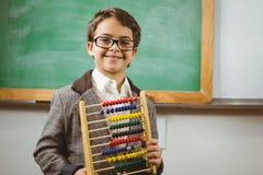 Uśmiechnięty uczeń ubierał up jako nauczyciela mienia abakus Obrazy Stock
