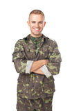 Uśmiechnięty wojsko żołnierz z jego rękami krzyżować Zdjęcia Stock