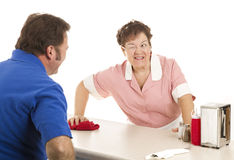 uśmiechu kelnerki mrugnięcie Obrazy Stock