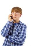 Używać jego telefon komórkowy nastoletnia chłopiec Obrazy Royalty Free