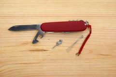 Używać kieszeniowy nóż Zdjęcie Stock