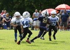 7U青年橄榄球赛跑者 免版税图库摄影