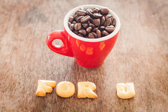 For u alphabet biscuit with red coffee cup Royalty Free Stock Images