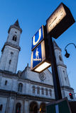 U-Bahn sign and St. Ludwig's Church (Ludwigskirche) in the eveni Royalty Free Stock Photo