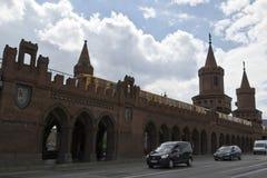 U-Bahn train and cars crossing Oberbaum Bridge Royalty Free Stock Images