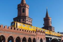U-Bahn train crossing the Oberbaum Bridge in Berlin Germany royalty free stock image