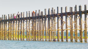 U Bein Bridge across the Taungthaman Lake. The 1.2 km  bridge was built around 1850 and is the ol stock video