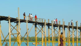 U Bein Bridge across the Taungthaman Lake. The 1.2 km  bridge was built around 1850 and is the ol stock video footage