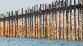 U Bein Bridge across the Taungthaman Lake. 1.2 km  bridge was built around 1850 and is the old stock video footage