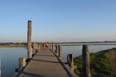 U Bein Bridge in Amarapura, Mandalay, Myanmar. U Bein Bridge and boats in Taungthaman Lake Royalty Free Stock Image