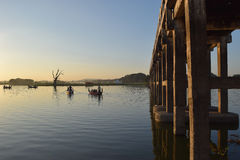 U Bein Bridge in Amarapura, Mandalay, Myanmar. U Bein Bridge an boats in Taungthaman Lake Stock Photos