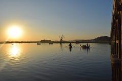U Bein Bridge in Amarapura, Mandalay, Myanmar. U Bein Bridge and boats in Taungthaman Lake Royalty Free Stock Photography