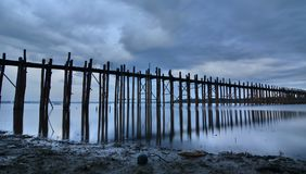 U Bein bridge at dusk. Amarapura. Mandalay region. Myanmar. U Bein Bridge is a crossing that spans the Taungthaman Lake near Amarapura in Myanmar Royalty Free Stock Photography