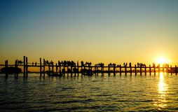 U Bein Bridge in Mandalay, Myanmar. View of the U Bein Bridge at sunset in Mandalay, Myanmar. Mandalay is the second-largest city and the last royal capital of Stock Photography
