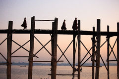 U Bein Bridge. Monks walking across the U-Bein bridge,mandalay,Myanmar.Photo taken in Dec 2014 Stock Images