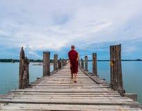 U Bein Bridge, Myanmar-Aug 26th, 2014: Myanmar monks Royalty Free Stock Photography