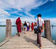 U Bein Bridge, Myanmar-Aug 26th, 2014: Myanmar monks Stock Image