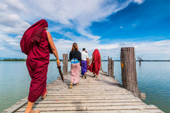 U Bein Bridge, Myanmar-Aug 26th, 2014: Myanmar monks Stock Images