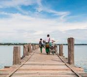 U Bein Bridge, Myanmar-Aug 26th, 2014: Myanmar people was walking Royalty Free Stock Image