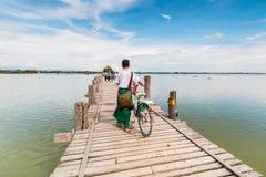 U Bein Bridge, Myanmar-Aug 26th, 2014: Myanmar people was walking Stock Photography