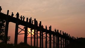 U Bein  bridge people silhouettes at sunset smooth dolly shot w sound stock video footage