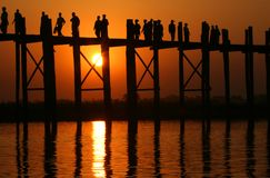 U Bein bridge and people at sunset Stock Photo