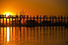 U Bein bridge and people at sunset. Famous U Bein bridge and people at sunset, Myanmar Royalty Free Stock Photo