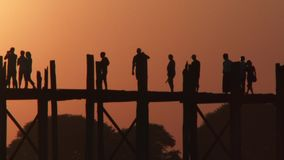 U Bein Bridge at sunset in Amarapura, Laos stock footage