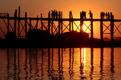 The U-Bein bridge at sunset with silhouettes Stock Photo