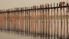 U Bein Bridge Sunset Time Lapse. Time Lapse of the famous U Bein Bridge at sunset in Amarapura, Myanmar stock video footage