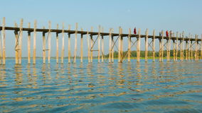 U Bein Bridge on Taungthaman Lake. The 1.2 km  bridge was built around 1850 and is the oldest and stock video footage