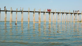 U Bein Bridge on Taungthaman Lake. The 1.2 km  bridge was built around 1850 and is the oldest and Stock Photos
