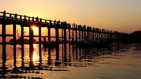 U Bein Wooden Bridge at Sunset 2. Famous U Bein bridge in Amarapura, near Mandalay in Myanmar (Burma) at sunset stock footage
