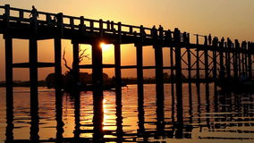 U Bein Wooden Bridge at Sunset 4. Famous U Bein bridge in Amarapura, near Mandalay in Myanmar (Burma) at sunset stock footage