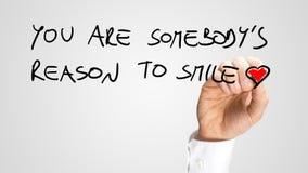 U bent somebody reden te glimlachen Stock Foto
