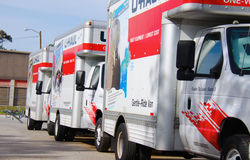U-HAUL moving trucks parked in a line. U-Haul trucks parked in a perfectly straight line on a sunny morning Royalty Free Stock Photography
