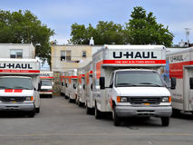U-Haul trucks in Brooklyn depot ready for movers. BROOKLYN, NEW YORK - JUNE 5, 2011: In this tight economy more people are moving themselves to save money. Here Royalty Free Stock Image