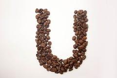U letter. the alphabet of buckwheat. Porridge. buckwheat grain. concept of healthy eating. photo for your design. horizontal sheet orientation stock photography