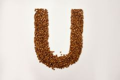 U letter. the alphabet of buckwheat. Porridge. buckwheat grain. concept of healthy eating. photo for your design. horizontal sheet orientation royalty free stock image