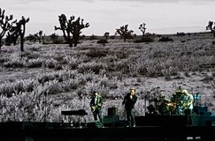 U2 playing live Royalty Free Stock Photography
