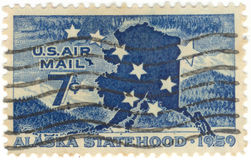 U.S. Air Mail Postage Stamp. Canceled 7 cent 1959 United States of America Alaska statehood airmail stamp Royalty Free Stock Photos