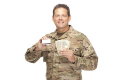 U.S. Army Soldier, Sergeant. Isolated with gift card and cash. Stock Image