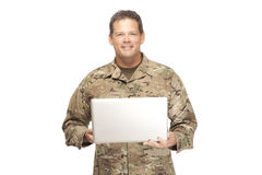 U.S. Army Soldier, Sergeant. Isolated with laptop. Royalty Free Stock Photography