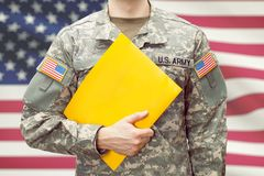USA army young soldier holding yellow folder in left hand Stock Images