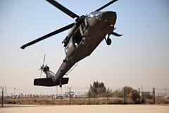 U.S. Blackhawk SH-60. KUWAIT - JANUARY 19: U.S. military Blackhawk SH-60 flares upon landing January 19, 2011 in Kuwait royalty free stock image