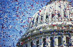 U.S. Capitol with red, white and blue balloons