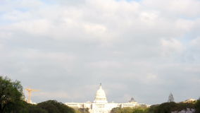 U.S. Capitol Under The Clouds. A cloudy sky passes above the U.S. Capitol Building stock footage