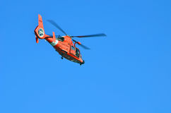 U.S. Coast Guard Helicopter. Flying over Government Cut inlet primary entrance to th Port of Miami Stock Photography